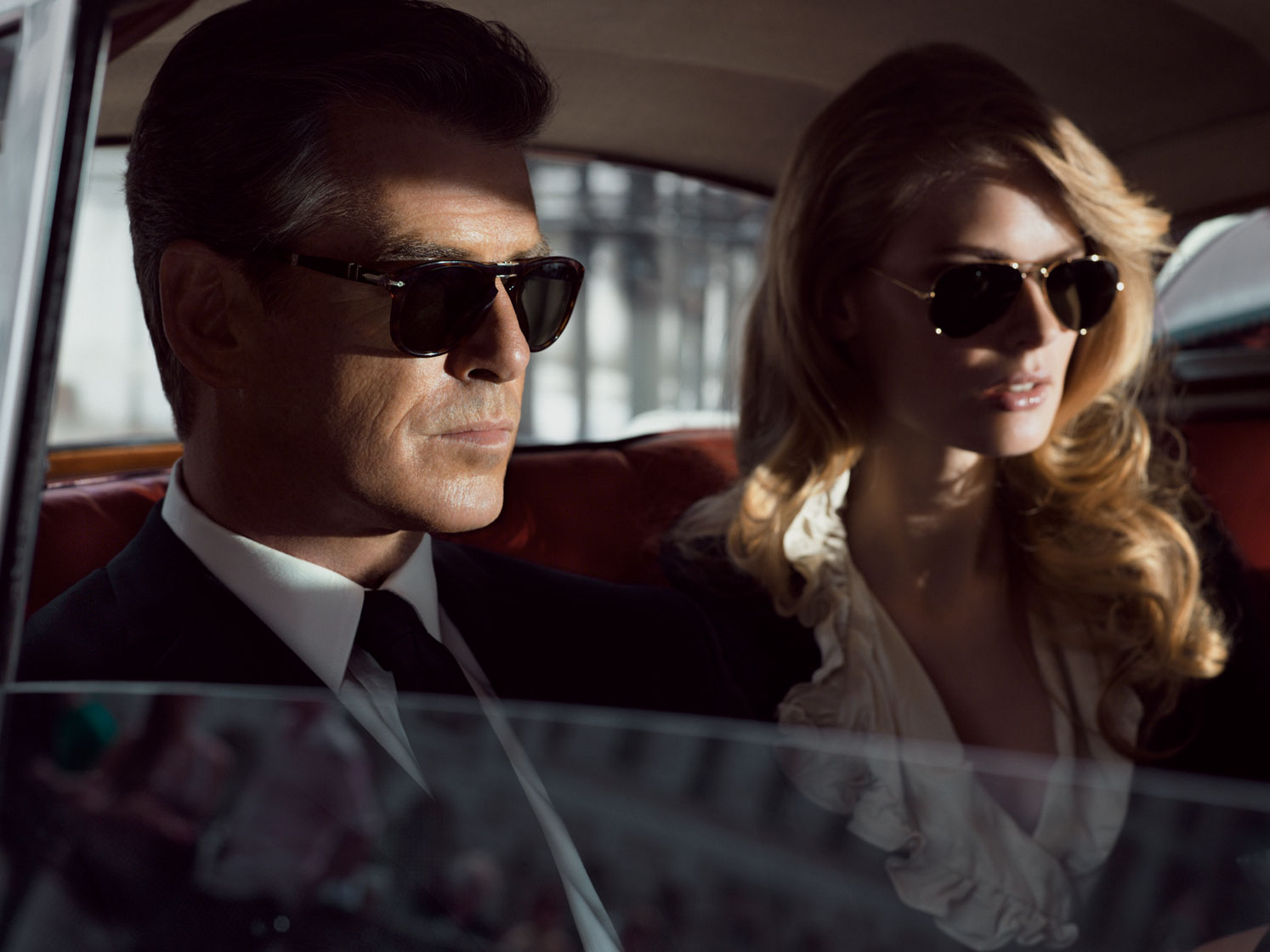 Pierce Brosnan in car with hot model for Aquascutum advert with Rosehip, Communications‭ ‬&‭ ‬Marketing