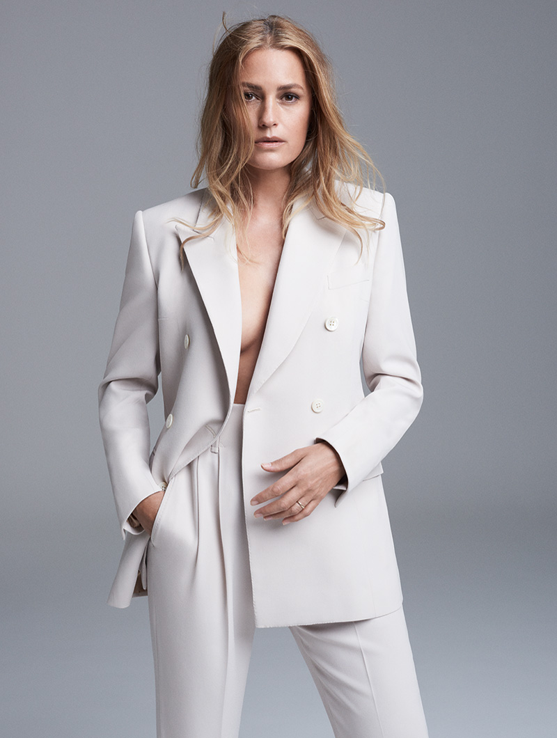 Yasmin Le Bon shot by Roger Rich wearing white trouser suit with Rosehip